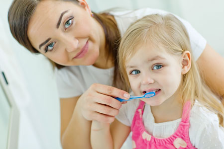 Mom and Daughter brushing their teeth - Pediatric Dentists - Pediatric Dentist in Ridgecrest, CA